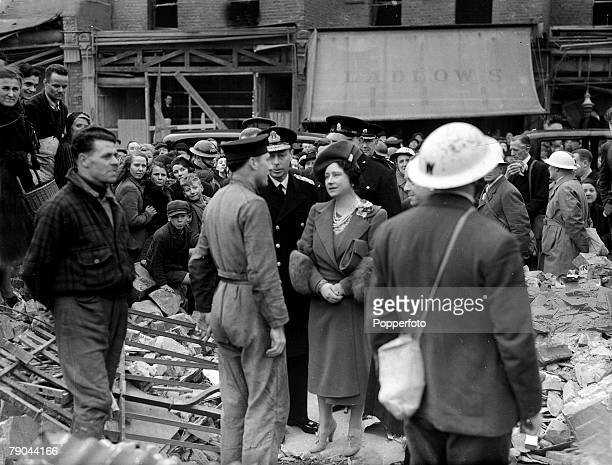 British Royalty World War II London England pic April 1941 HM King George VI and Queen Elizabeth inspecting bomb damage in London's East End after...