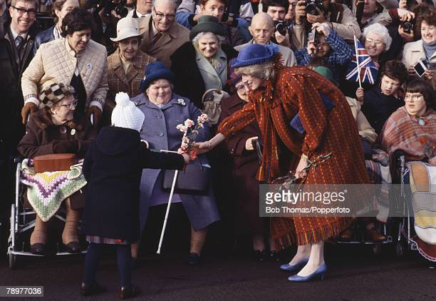 British Royalty Wrexham Wales 26th November 1982 Princess Diana receives a small gift of flowers from a young child while meeting the crowds during a...