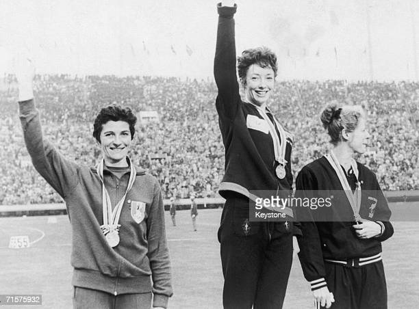 British runner Ann Packer centre with her gold medal for the 800 metres event at the Tokyo Olympics 21st October 1964 Maryvonne Dupureur left won the...