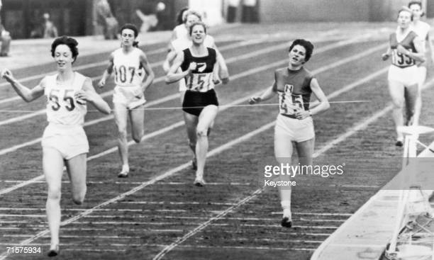 British runner Ann Packer no 55 breaking the world record to win the gold medal in the 800 metres event at the Tokyo Olympics 21st October 1964...