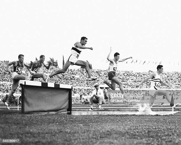 British runner Don Chapman leading the race ahead of Zdzislaw Krzyszkowiak of Poland and Ludwig Muller during the 3000m steeplechase heats at the...