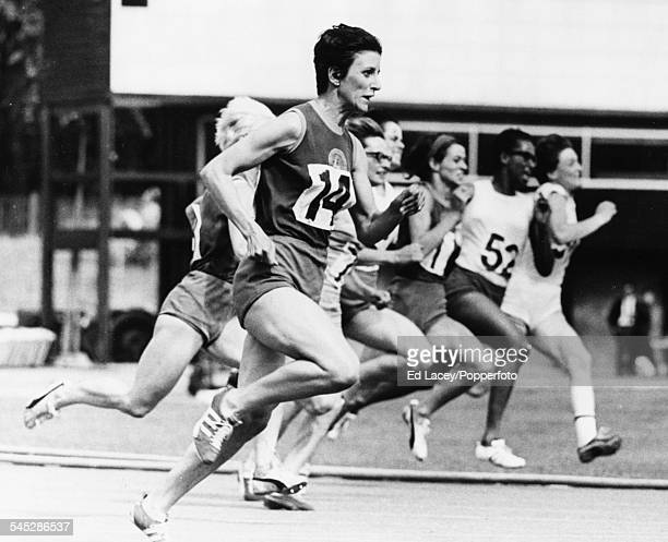 British runner Dorothy Hyman sprints to the finish line to win the 200m final at the Women's Amateur Athletic Association Championships Crystal...