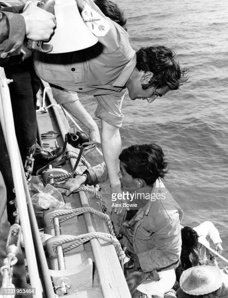 British sailor offers a hand to South Vietnamese refugees – known as boat people – who approached a British Royal Fleet Auxiliary ship for sanctuary...