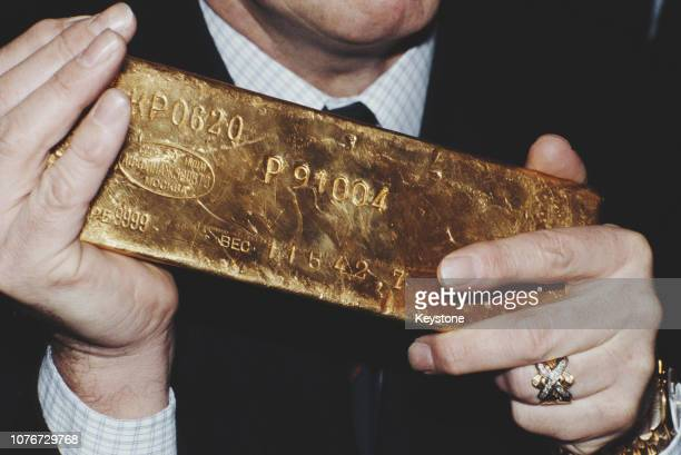 British salvage diver Keith Jessop of Jessop Marine holding the first gold bar recovered from the British cruiser 'HMS Edinburgh' circa 1981 The...
