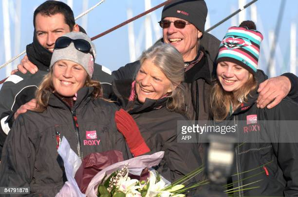 British Samantha Davies poses with her father Paul and her mother Jenny after she crossed the finish line of the Vendee Globe roundtheworld solo...