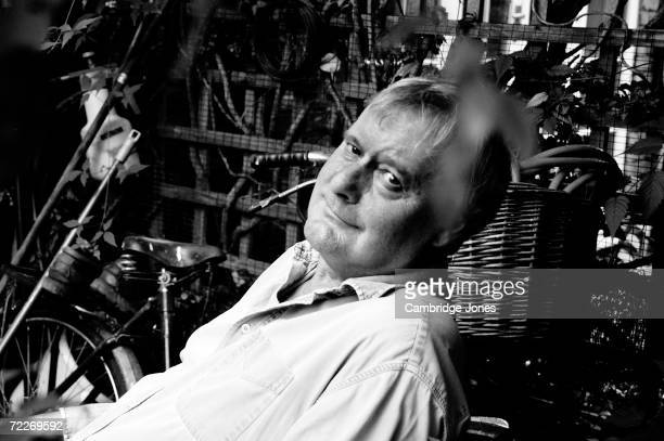 British satirist comedian writer and actor John Fortune poses at his home in LondonEngland during March of 2004