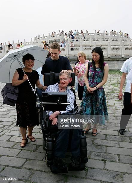 British scientist Stephen Hawking accompanied by his assistant temple workers and other personnel visits the Temple of Heaven June 18 2006 in Beijing...