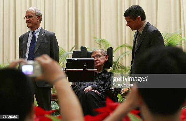 British scientist Stephen Hawking attends a photo call with US physicists David Gross and Andrew Strominger at the opening ceremony of Strings 2006...