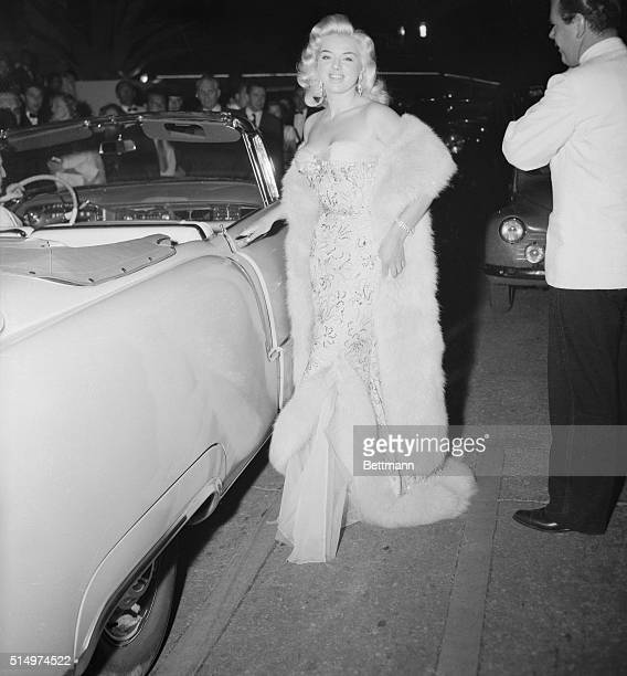 British screen beauty Diana Dors is one of the many international lovelies attending the Cannes Film Festival The blond star poses for the...