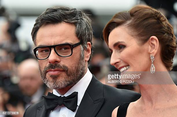 British screenwriter Lucy Dahl and New Zealander actor Jemaine Clement pose on May 14 2016 as they arrive for the screening of the film The BFG at...