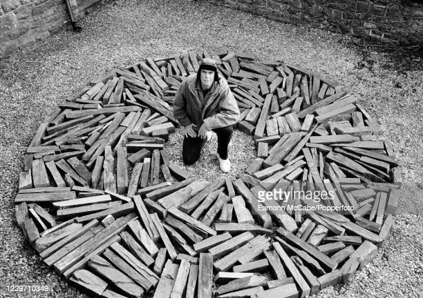 """British sculptor and land-artist Sir Richard Long with his piece, """"South Bank Circle"""" now at Tate Liverpool, on 8th January 2003."""