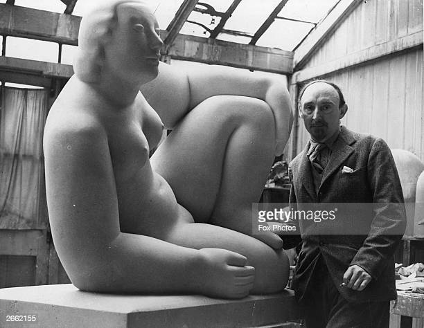 British sculptor Frank Dobson with his stone figure entitled 'Pax' Original Publication People Disc HC0045