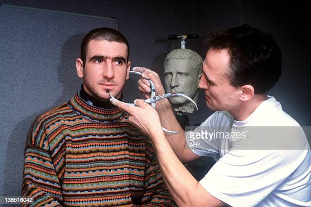 British sculptor Mark Richards takes measures of the head of French soccer Eric Cantona Manchester United striker to realize his wax figure for Madam...