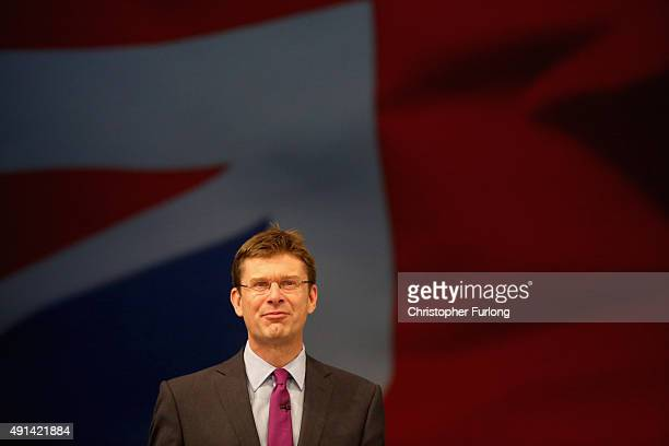 British Secretary of State for Communities and Local Government Greg Clark addresses delegates on the second day of the annual Conservative party...