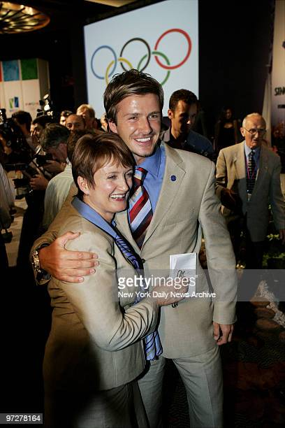 British Secretary of State for Culture Media and Sport Tessa Jowell gets a hug from soccer star David Beckham as they celebrate after the...