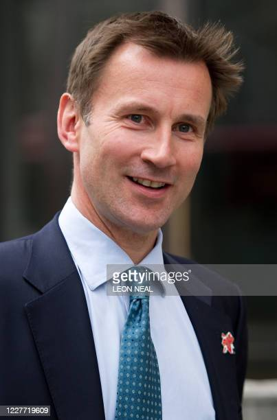 British Secretary of State for Culture, Olympics, Media and Sport, Jeremy Hunt, leaves his office to make a statement in the House of Commons in...