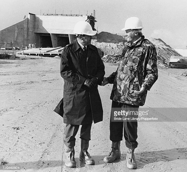 British Secretary of State for Defence Michael Heseltine with US Airforce Colonel Robert M Thompson at the RAF's Greenham Common airbase Berkshire...
