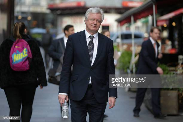 British Secretary of State for Exiting the European Union David Davis walks to his car as after leaving LBC radio station's Leicester Square studio...