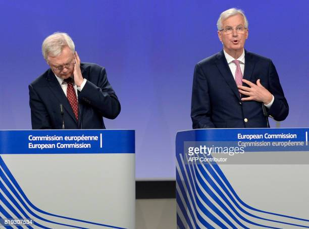 British Secretary of State for Exiting the European Union David Davis listens to European Union Chief Negotiator in charge of Brexit negotiations...