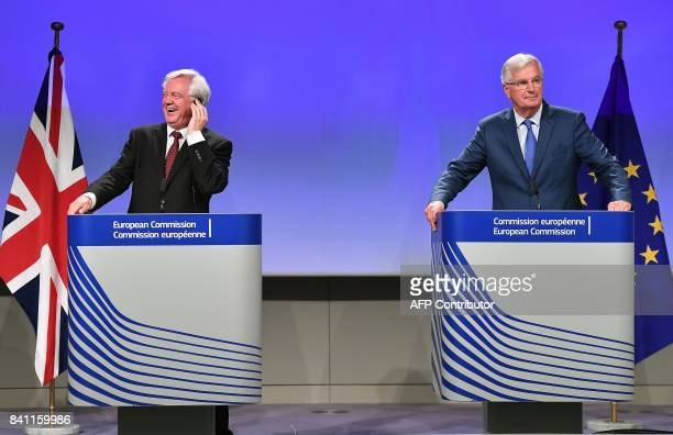 British Secretary of State for Exiting the European Union David Davis and EU chief Brexit negotiator Michel Barnier address media representatives at...