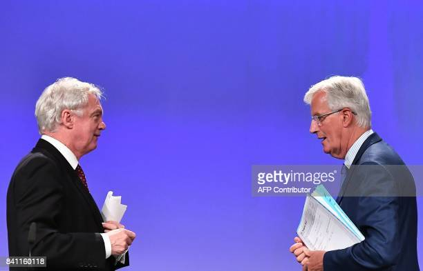 British Secretary of State for Exiting the European Union David Davis and EU chief Brexit negotiator Michel Barnier leave after addressing media...
