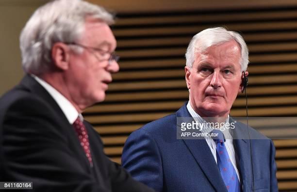 British Secretary of State for Exiting the European Union David Davis and EU chief Brexit negotiator Michel Barnier address media representatives at...