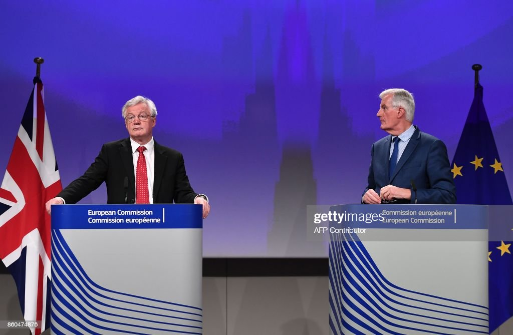 British Secretary of State for Exiting the European Union (Brexit Minister) David Davis (L) and European Union Chief Negotiator in charge of Brexit negotiations with Britain Michel Barnier address media representatives at the European Union Commission in Brussels on October 12, 2017. /