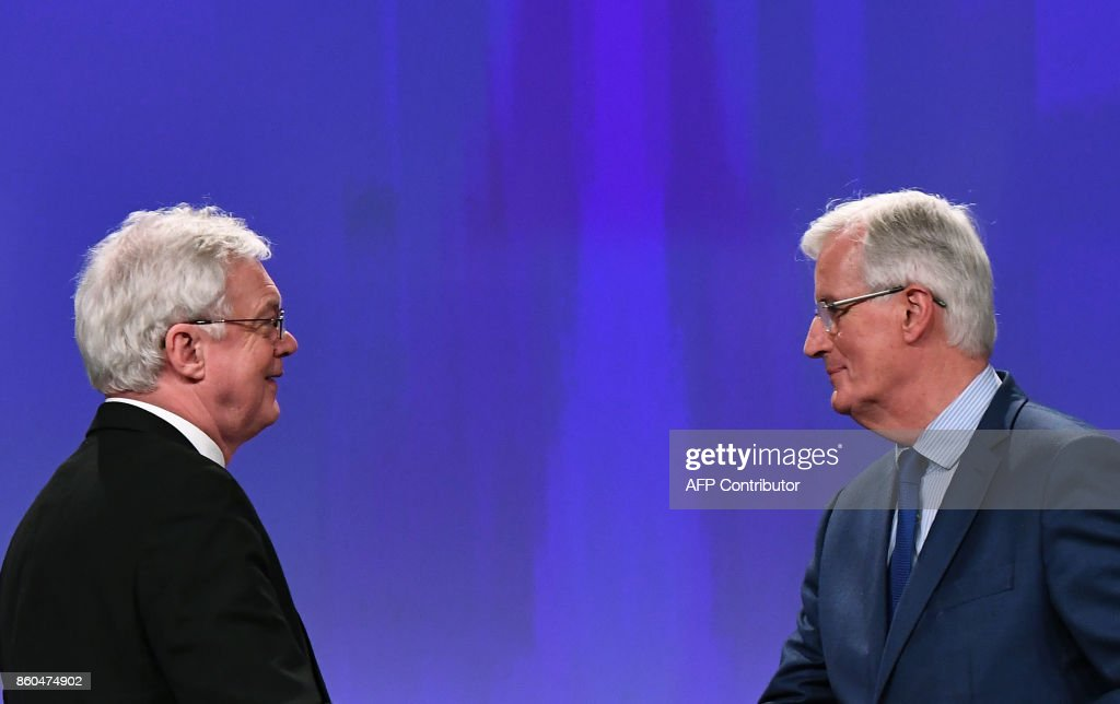 British Secretary of State for Exiting the European Union (Brexit Minister) David Davis (L) and European Union Chief Negotiator in charge of Brexit negotiations with Britain Michel Barnier leave after addressing media representatives at the European Union Commission in Brussels on October 12, 2017. /