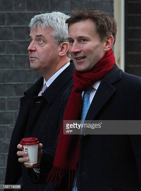 British Secretary of State for Health Andrew Lansley and Culture Secretary Jeremy Hunt arrive for a Cabinet meeting at 10 Downing Street in London on...