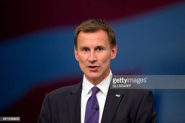 British Secretary of State for Health Jeremy Hunt addresses delegates on the third day of the annual Conservative party conference in Manchester...