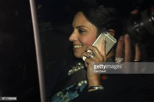 British Secretary of State for International Development Priti Patel talks on a mobile phone in a car as she arrives to Downing Street on November 8...