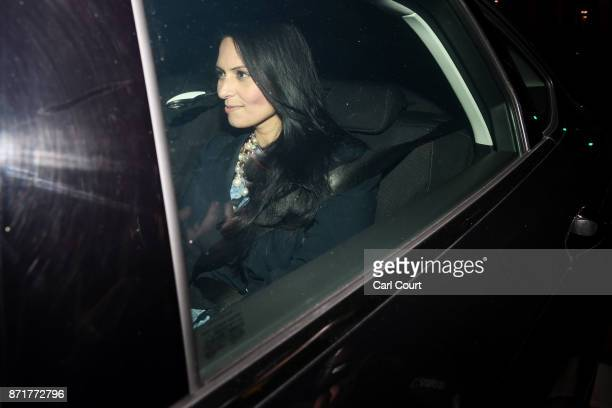 British Secretary of State for International Development Priti Patel sits in a car as she departs Downing Street after resigning her position on...