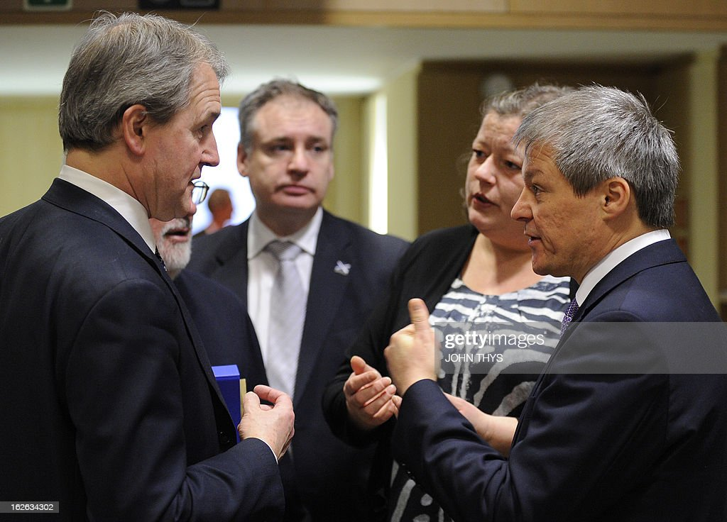 British Secretary of State for the Environment, Food, & Rural Affairs Owen William Paterson (L) talks with British Rurals Affairs Minister Richard Lochhead (C), Danish Agriculture minister Mette Gjerskov (2ndR) and EU Agriculture and Rural Development commissioner Dacian Ciolos (R) before an EU Agriculture Council meeting at the EU Headquarters in Brussels on February 25, 2013. -EU agriculture ministers discuss the Europe-wide horsemeat scandal and measures aimed at overhauling the Common Agricultural Policy.