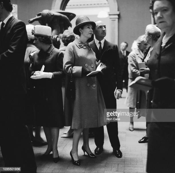 British Secretary of State for War John Profumo with his wife actress Valerie Hobson at the private view of the Royal Academy summer exhibition at...