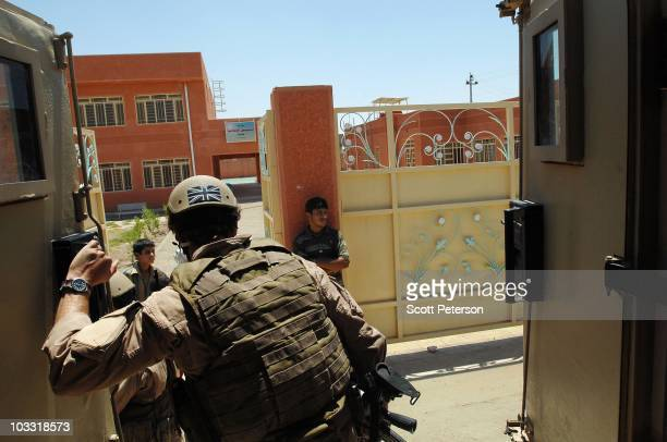British security guard contractor with Aegis systems steps out of an armored vehicle while escorting officers of the US Army Corps of Engineers...