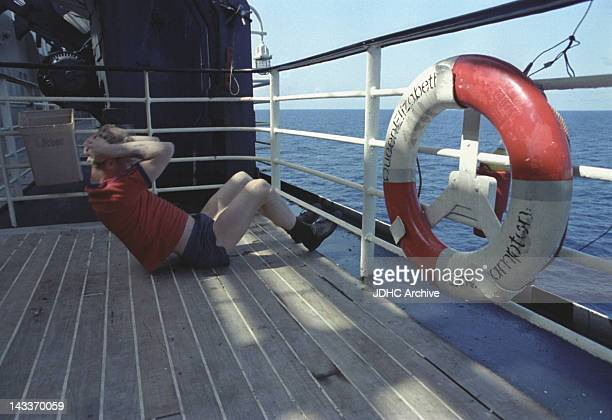A British serviceman training on board the Cunard liner QE2 which has been refitted as a troopship and is heading for the Falkland Islands during the...