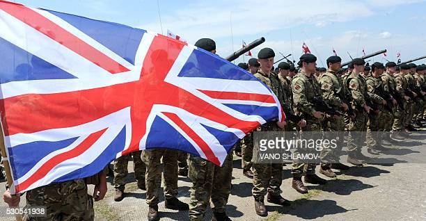 British servicemen attend an opening ceremony of the joint military exercise Noble Partner 2016 at the Vaziani training area outside Tbilisi on May...