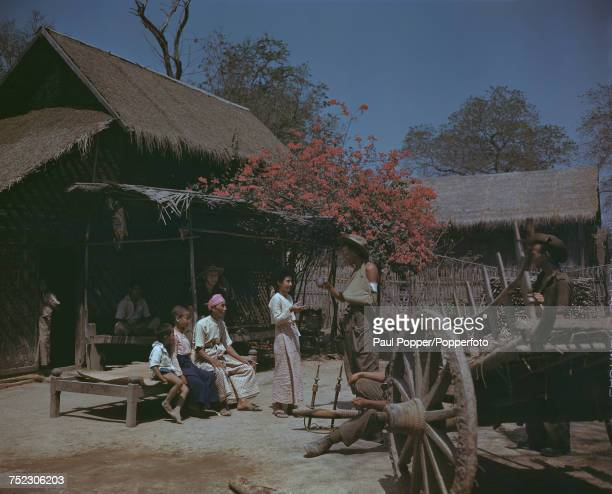 British servicemen with local people at Fort Dufferin Burma after the British recaptured the fortress from Japanese forces during World War II March...