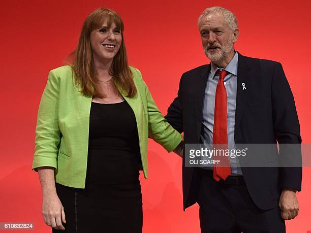 British Shadow Education Secretary Angela Rayner stands with Leader of the opposition Labour Party Jeremy Corbyn on stage on the third day of annual...