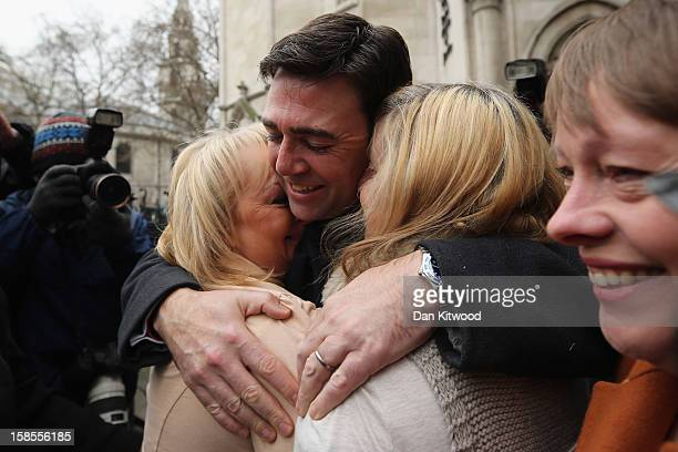 British Shadow Health Secretary and Labour Party member Andy Burnham embraces Jenni Hicks who lost her two teenage daughters Sarah and Victoria and...