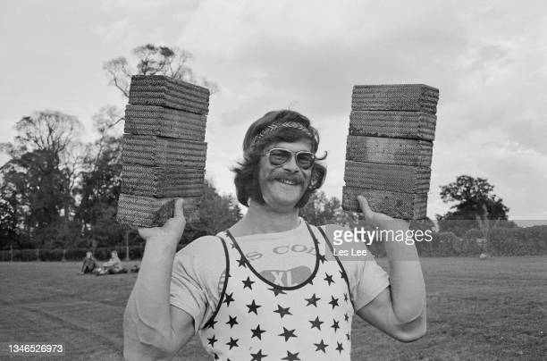 British shot putter Mike Winch takes part in a brick throwing contest, UK, 29th September 1974.