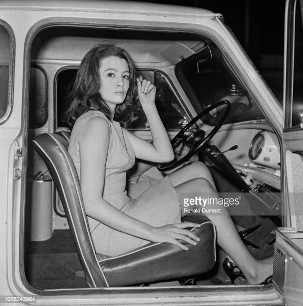 British showgirl and fashion model Christine Keeler currently involved in the Profumo Affair pictured seated in the driver's seat of an Austin Mini...