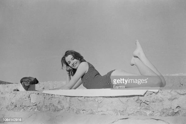 British showgirl and fashion model Christine Keeler known for her role in the Profumo Affair posed wearing a swimsuit on a beach in Spain on 12th...