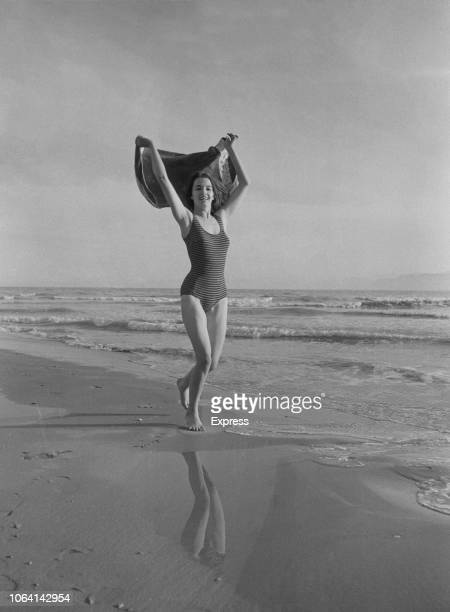 British showgirl and fashion model, Christine Keeler , known for her role in the Profumo Affair, pictured wearing a swimsuit on a beach in Spain on...