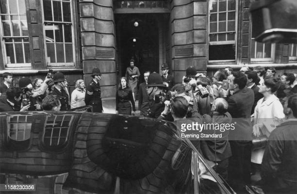 British showgirl and model, Christine Keeler leaving Marlborough Street Magistrates Court, where she is on trial for perjury and conspiring to...