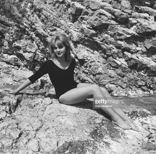British showgirl and model Mandy RiceDavies currently involved in the Profumo Affair pictured posed on a rock wearing a leotard on 6th May 1963