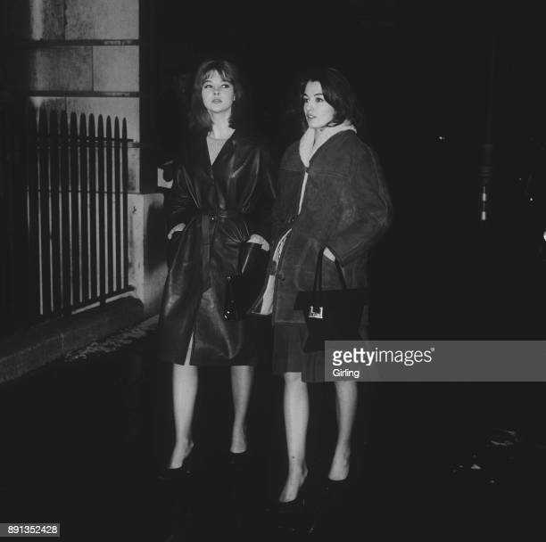 British showgirls Christine Keeler and Mandy RiceDavies walking together London UK 17th January 1963 Both were known for their roles in the Profumo...