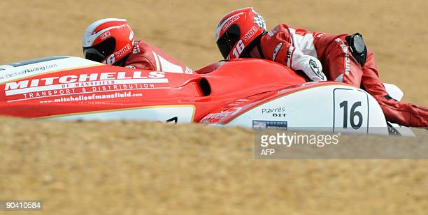 British sidecar riders Ben and Tom Birchall ride their side car on the Le Mans racetrack on September 6 2009 at Le Mans racetrack They placed second...