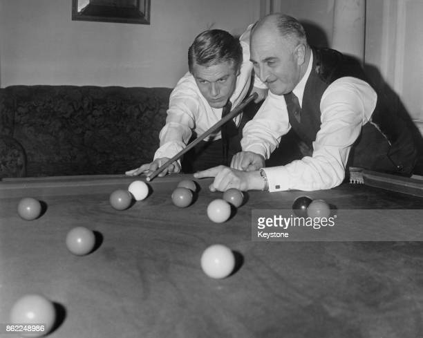 British singer Adam Faith receives private snooker lessons from billiards and snooker player Sydney Lee at Burroughs and Watts in Soho Square London...
