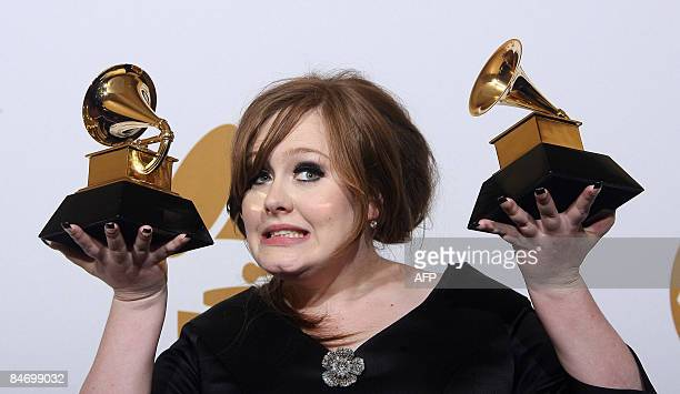 British singer Adele holds the Grammy awards for the Best New Artist and Best Female Pop Vocal Performance for Chasing Pavements during the 51st...